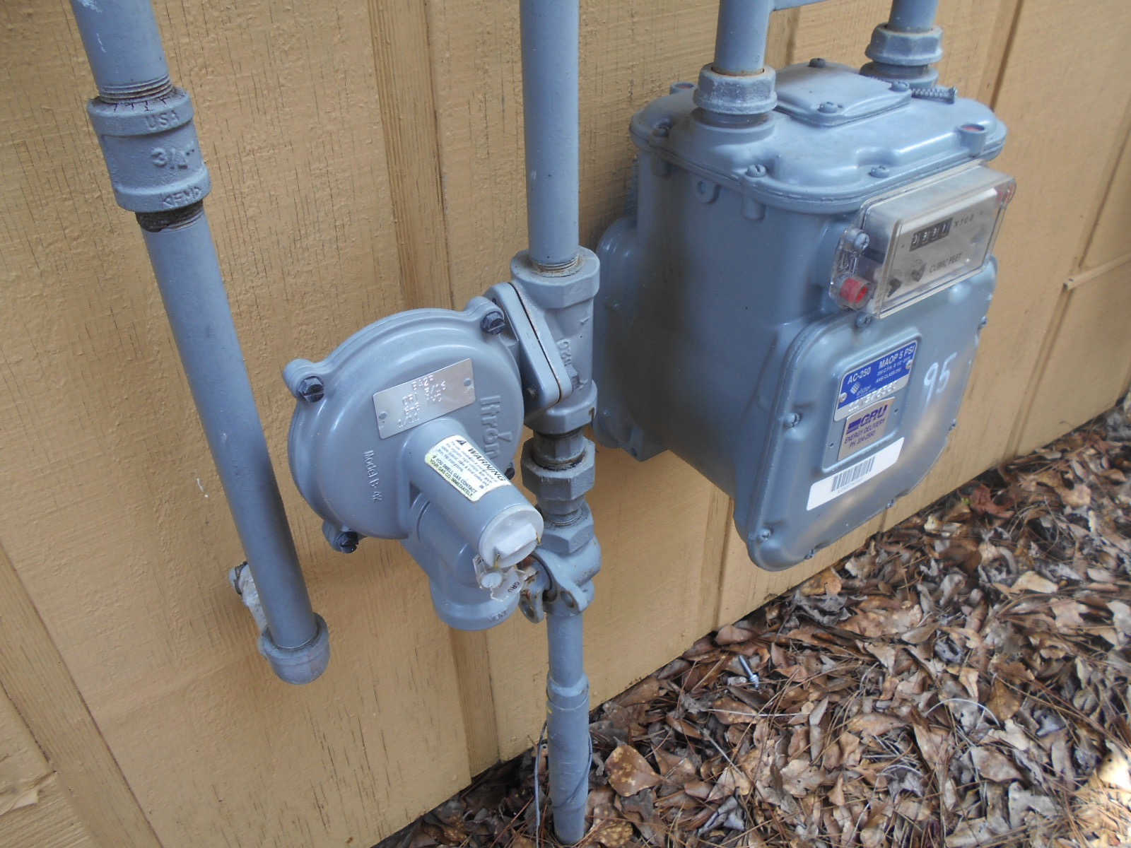 Is it normal to smell gas near a natural gas meter?